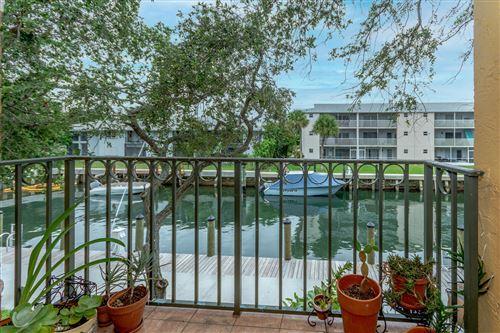 Photo of 1115 Lake Shore Drive #202, Lake Park, FL 33403 (MLS # RX-10743496)