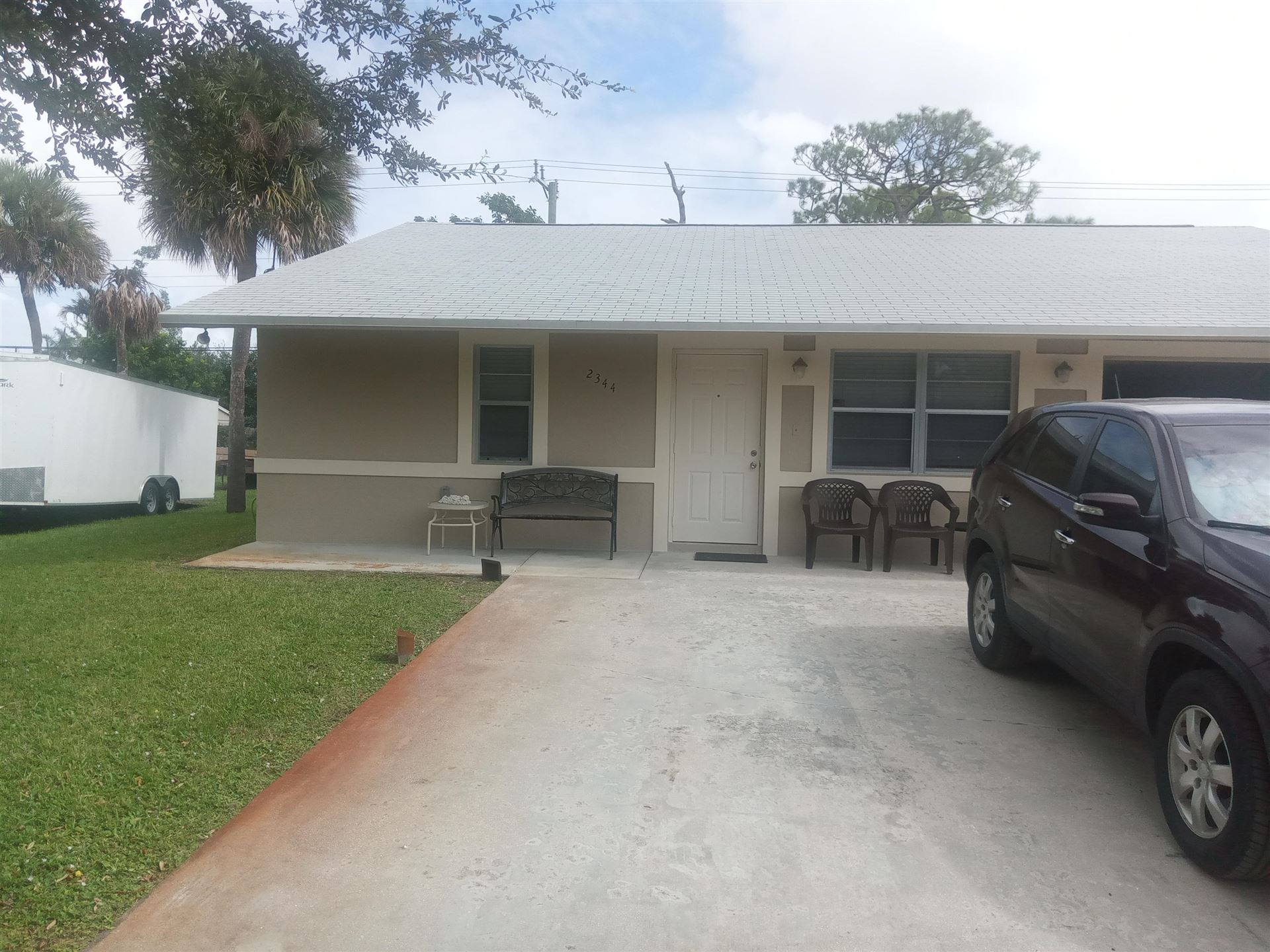 Photo of 2344 Taylor Lane, West Palm Beach, FL 33415 (MLS # RX-10669496)