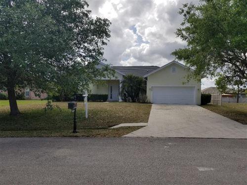 Photo of 5840 NW Windy Pines Lane, Port Saint Lucie, FL 34986 (MLS # RX-10614498)
