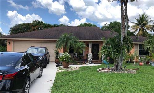 Photo of 343 Sandpiper Avenue, Royal Palm Beach, FL 33411 (MLS # RX-10733501)
