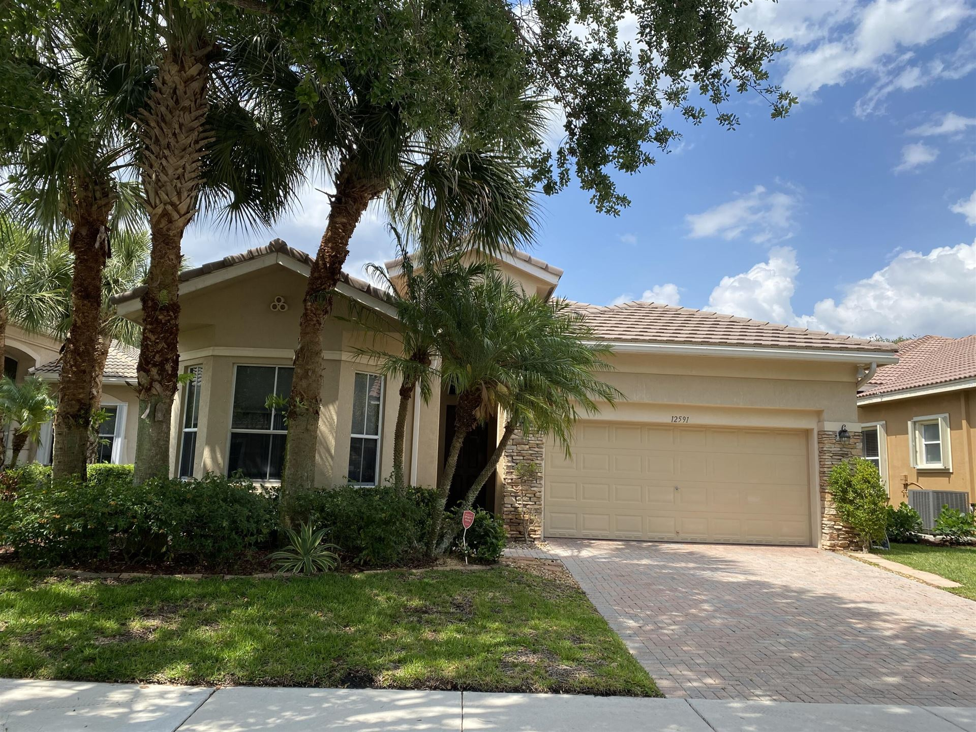 Photo of 12591 NW 78th Manor, Parkland, FL 33076 (MLS # RX-10714501)