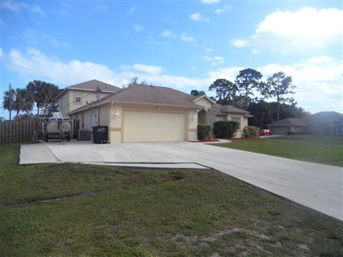 Photo of 2497 SW Roney Road, Port Saint Lucie, FL 34953 (MLS # RX-10593502)