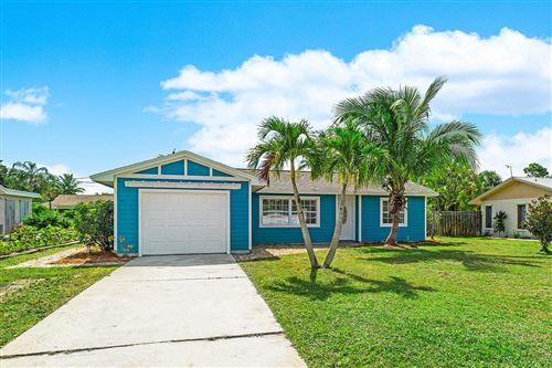 Photo of 1665 NE Darlich Avenue, Jensen Beach, FL 34957 (MLS # RX-10638507)
