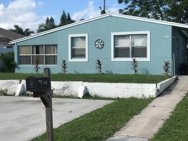Photo of 1080 W 26th Street, Riviera Beach, FL 33404 (MLS # RX-10670510)