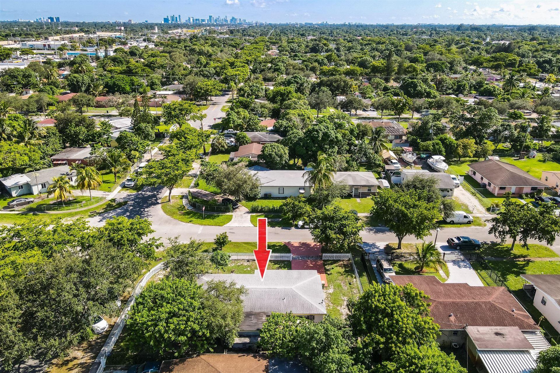 Photo of 805 NW 128th Street, North Miami, FL 33168 (MLS # RX-10656516)