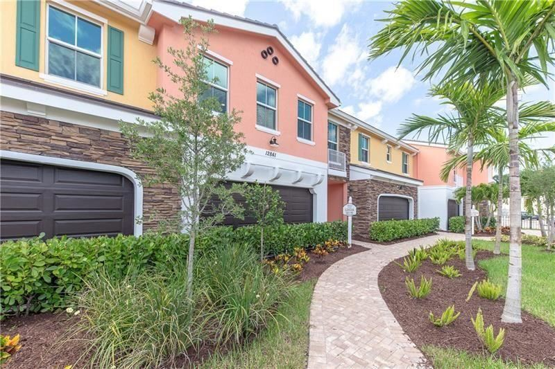 Photo of 12841 Trevi Isle Drive #14, Palm Beach Gardens, FL 33418 (MLS # RX-10699516)