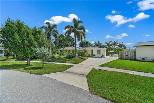 Photo of 929 Dogwood Road, North Palm Beach, FL 33408 (MLS # RX-10751517)