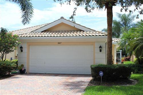 Photo of 667 Hudson Bay Drive, Palm Beach Gardens, FL 33410 (MLS # RX-10632518)
