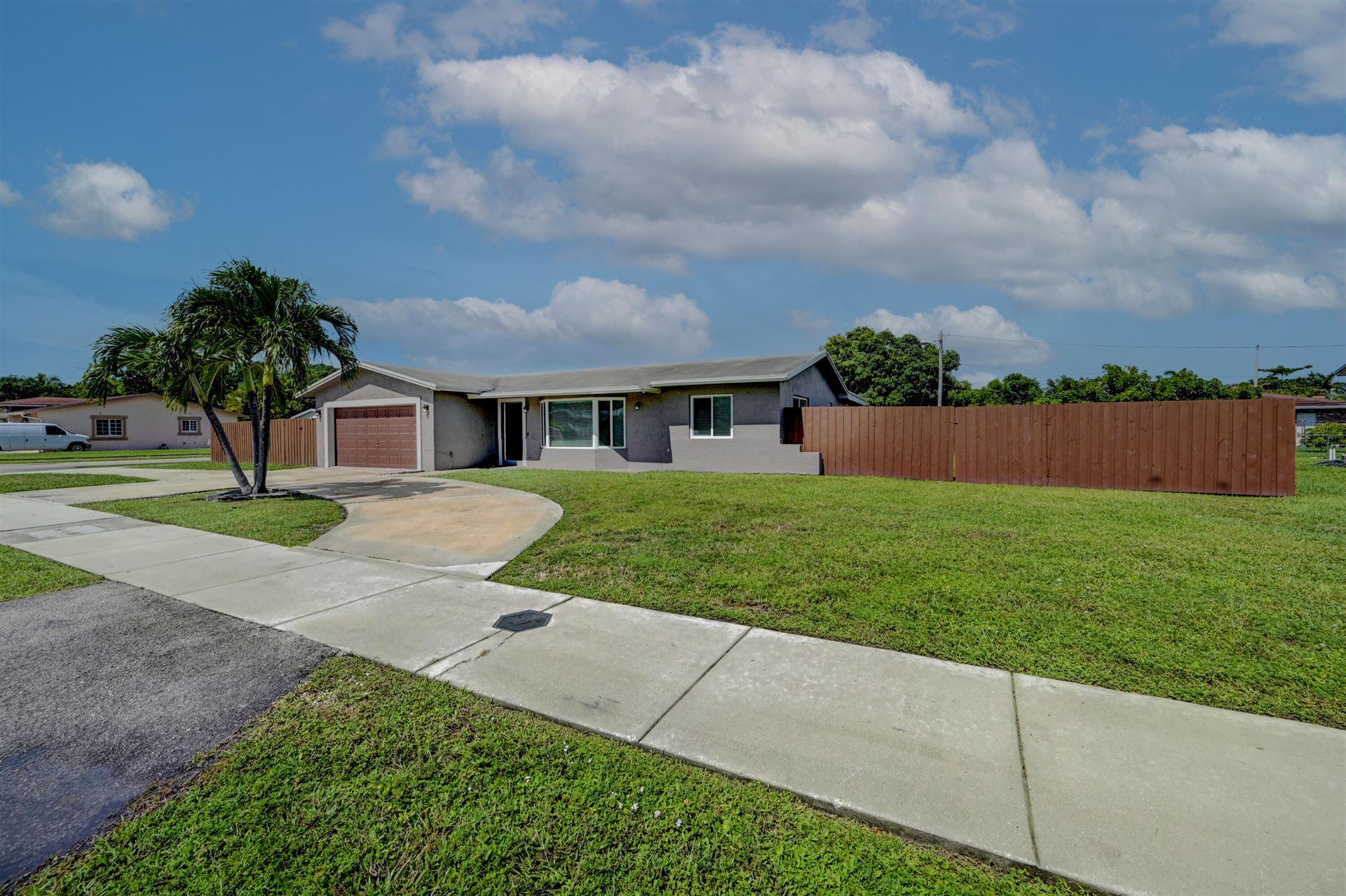 Photo of 601 NE 40th Street, Deerfield Beach, FL 33064 (MLS # RX-10751518)