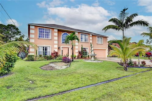 Photo of 4110 SW Utterback Street, Port Saint Lucie, FL 34953 (MLS # RX-10752522)