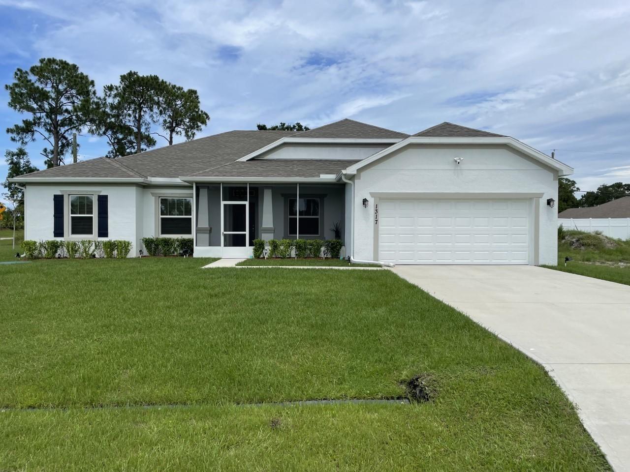 Photo of 1317 SE Odonnell Lane, Saint Lucie West, FL 34983 (MLS # RX-10726523)