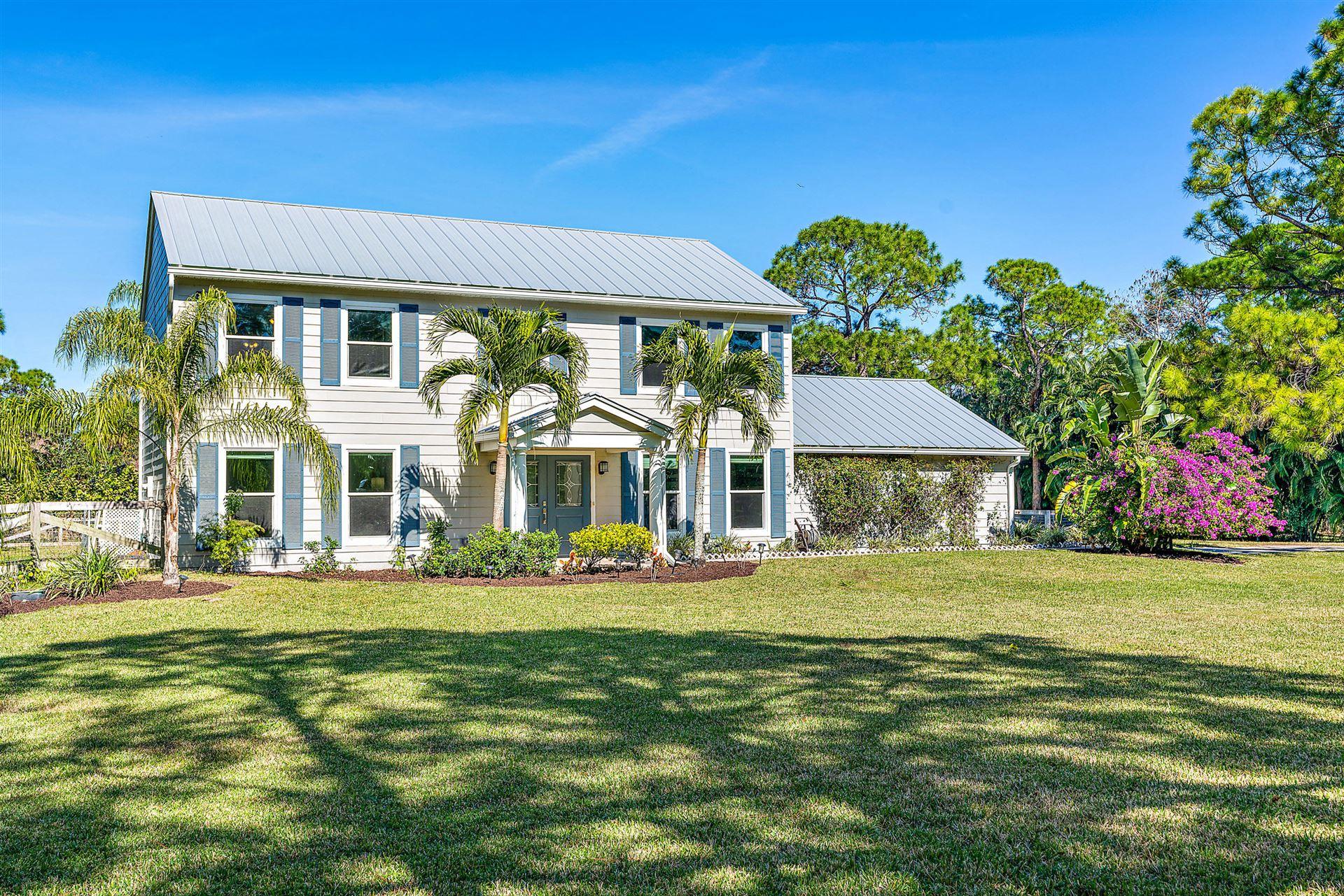Photo of 7127 154th Court N, Palm Beach Gardens, FL 33418 (MLS # RX-10686528)