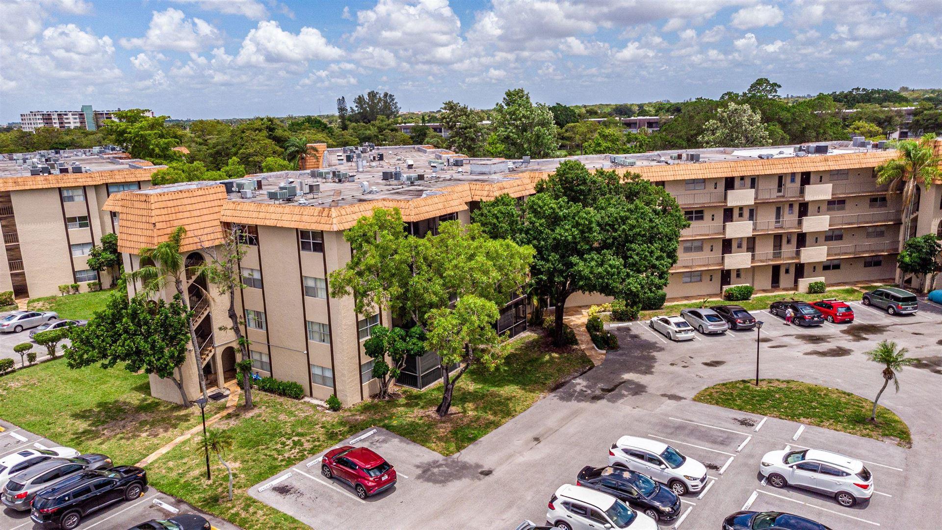 Photo of 6101 N Falls Cir Drive #204, Lauderhill, FL 33319 (MLS # RX-10732529)