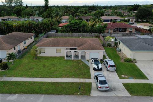 Photo of 4675 Betelnut Street, Boca Raton, FL 33428 (MLS # RX-10754530)