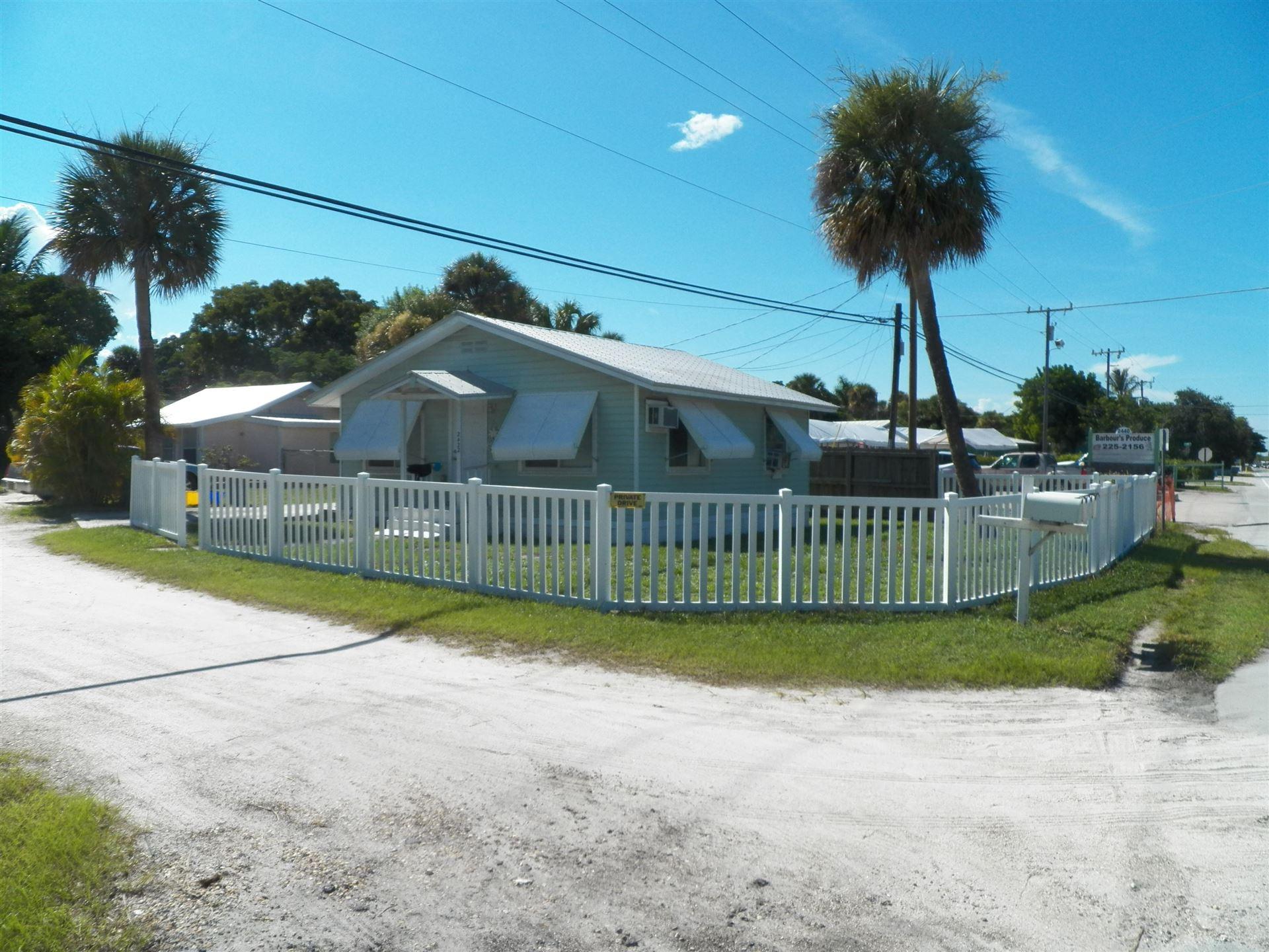 Photo of 2422 NE Indian River Drive, Jensen Beach, FL 34957 (MLS # RX-10645530)