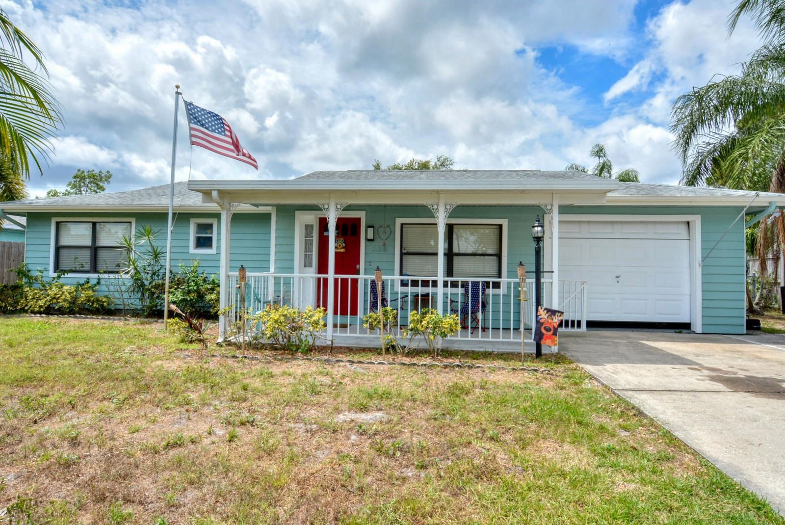 Photo of 338 NE Greenbrier Avenue, Port Saint Lucie, FL 34983 (MLS # RX-10715530)