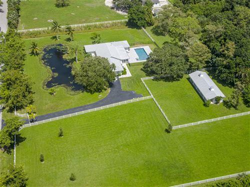 Photo of 7000 NW 87th Avenue, Parkland, FL 33067 (MLS # RX-10656531)
