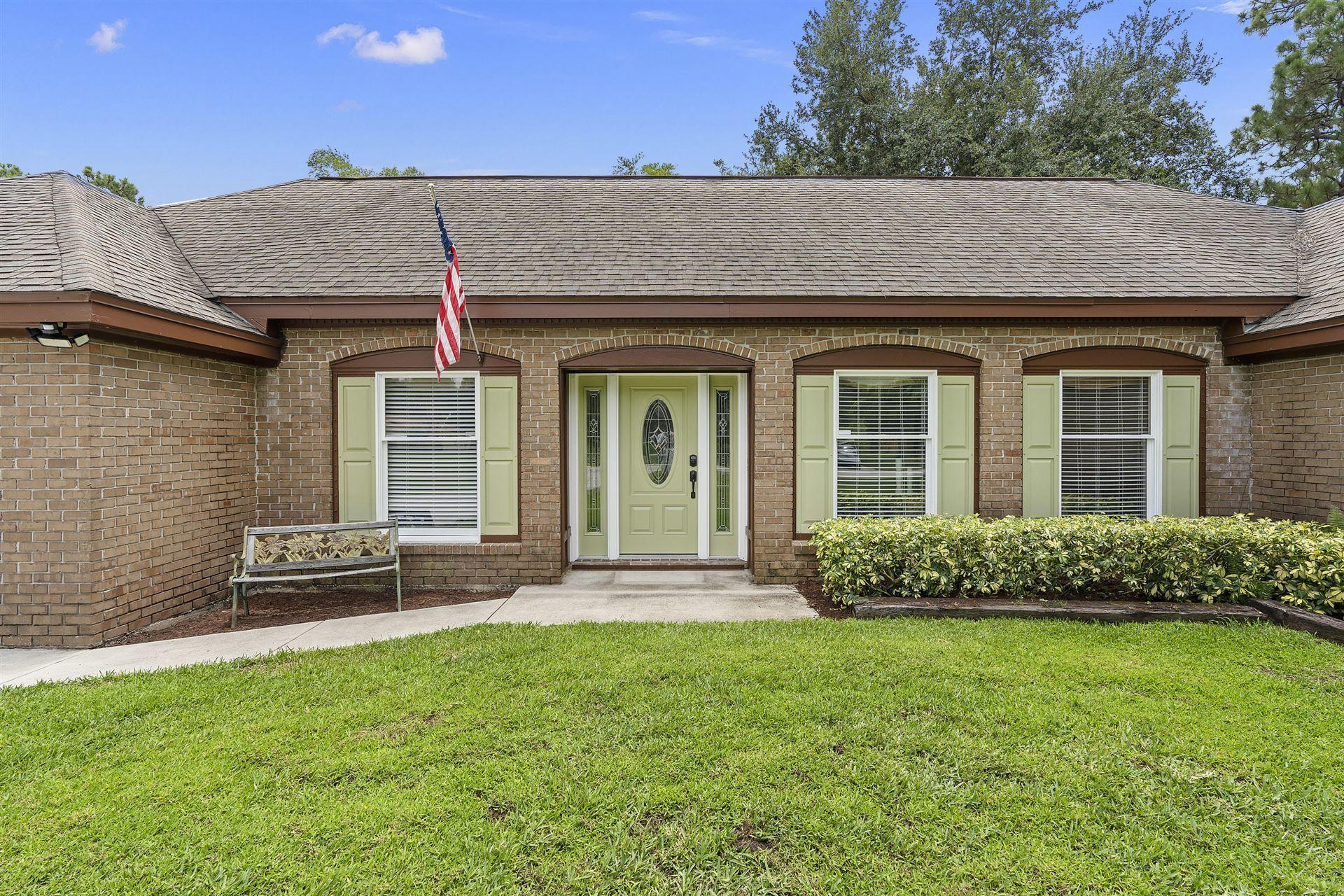 Photo of 8521 Hidden Pines Road, Fort Pierce, FL 34945 (MLS # RX-10726532)