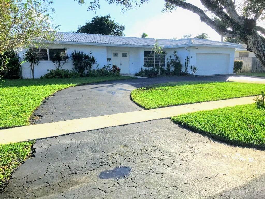Photo of 7480 NW 10th Court, Plantation, FL 33313 (MLS # RX-10671535)