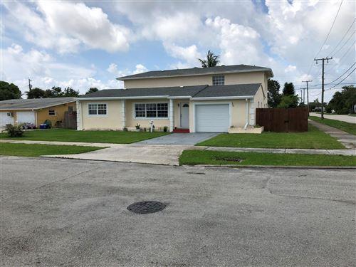 Foto de inmueble con direccion 356 Cypress Drive Lake Park FL 33403 con MLS RX-10618536