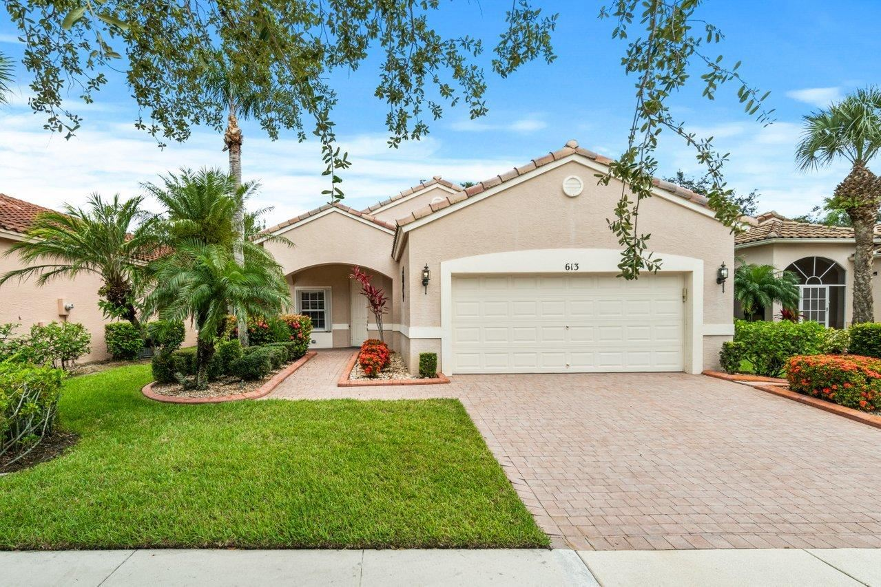 Photo of 613 NW Whitfield Way, Port Saint Lucie, FL 34986 (MLS # RX-10732537)