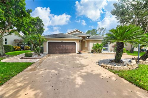 Photo of 5705 NW 46th Drive, Coral Springs, FL 33067 (MLS # RX-10628541)