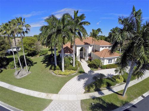 Photo of 10873 Egret Point Lane, West Palm Beach, FL 33412 (MLS # RX-10320542)