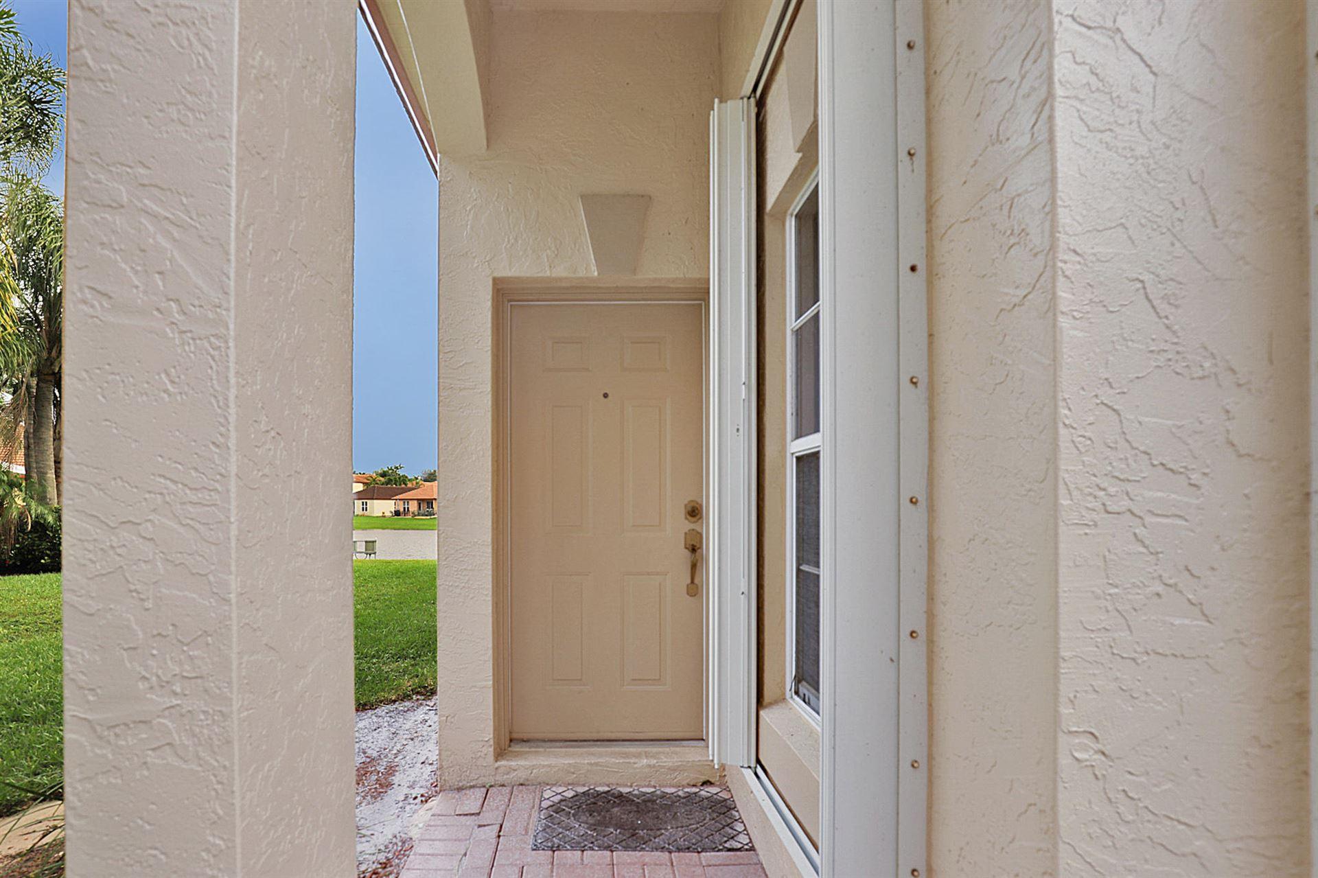 Photo of 1004 Via Jardin, Riviera Beach, FL 33418 (MLS # RX-10670542)