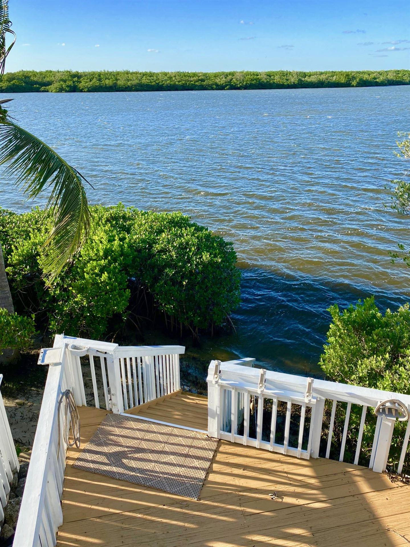 Photo of 2408 Harbour Cove Drive, Hutchinson Island, FL 34949 (MLS # RX-10684545)