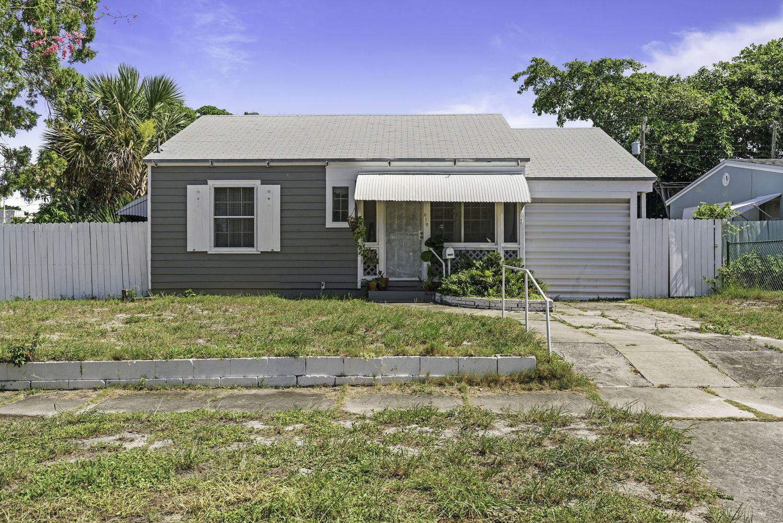 Photo of 810 Palmetto Street, West Palm Beach, FL 33405 (MLS # RX-10636548)