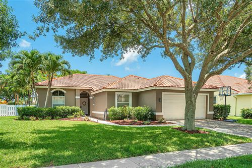 Photo of 5555 Lake Shore Village Circle, Lake Worth, FL 33463 (MLS # RX-10626549)