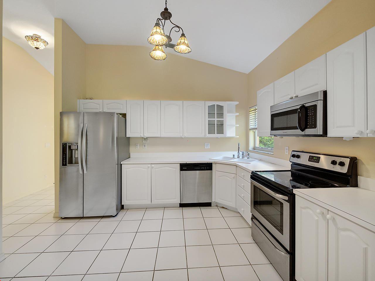 Photo of 8059 Via Hacienda, Riviera Beach, FL 33418 (MLS # RX-10653549)