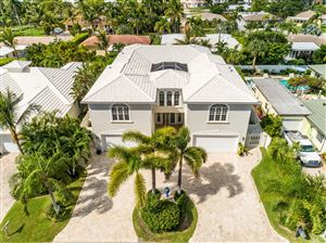 Photo of 225 Claremont Lane, Palm Beach Shores, FL 33404 (MLS # RX-10541552)