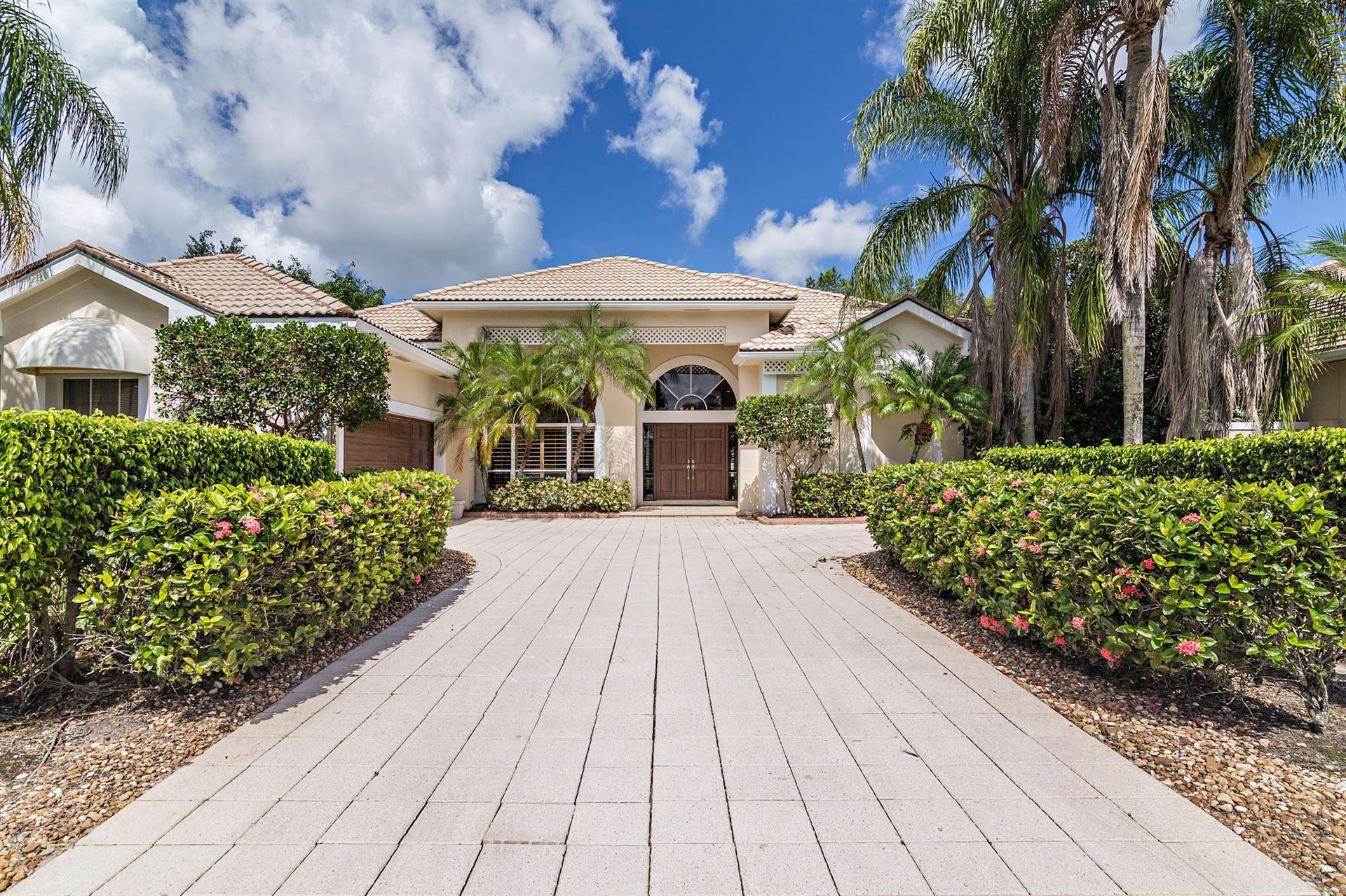 Photo of 14 Windward Isle, Palm Beach Gardens, FL 33418 (MLS # RX-10651555)