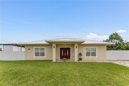 Photo of 1550 Magnolia Drive, West Palm Beach, FL 33417 (MLS # RX-10754559)