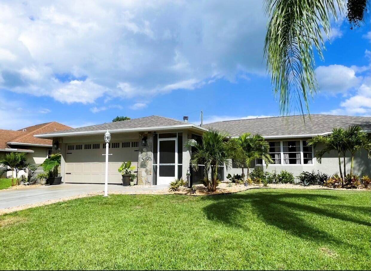 Photo of 2589 SW Kenilworth Street, Port Saint Lucie, FL 34953 (MLS # RX-10746560)