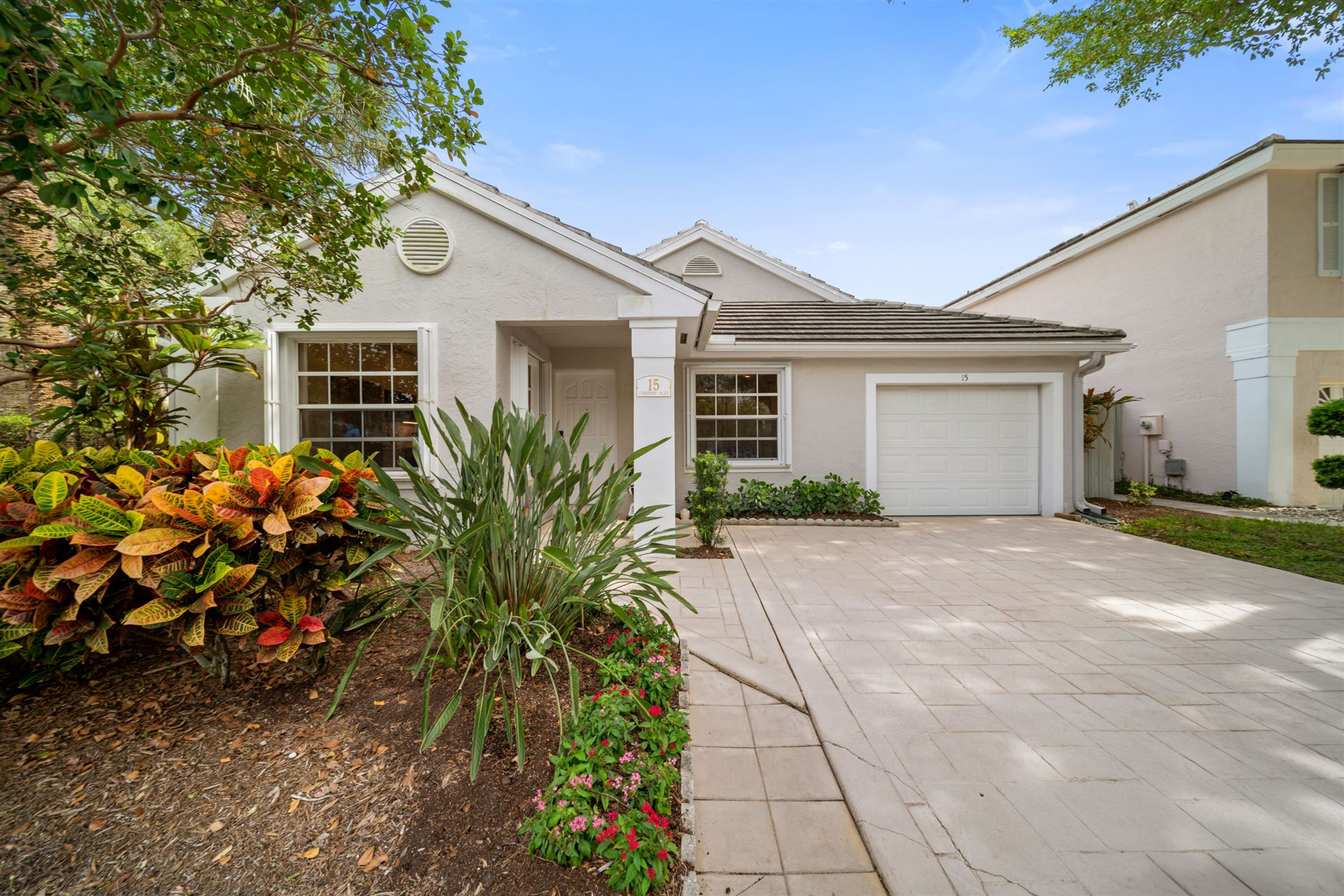Photo of 15 Commodore Place, Palm Beach Gardens, FL 33418 (MLS # RX-10730561)