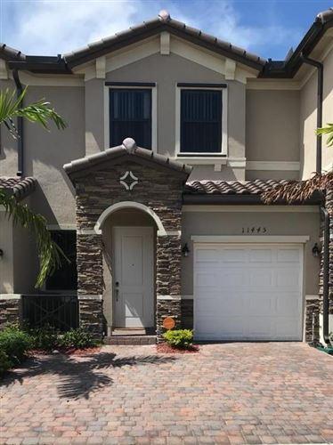 Photo of 11445 SW 252nd Terrace, Homestead, FL 33032 (MLS # RX-10693564)