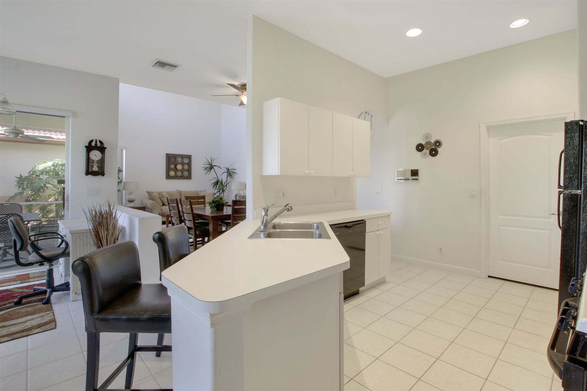 Photo of 10 Porta Vista Circle, Palm Beach Gardens, FL 33418 (MLS # RX-10635565)