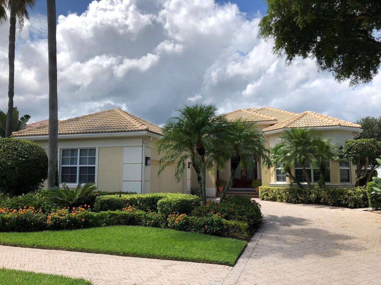 Photo of 119 Banyan Isle Drive, Palm Beach Gardens, FL 33418 (MLS # RX-10746565)