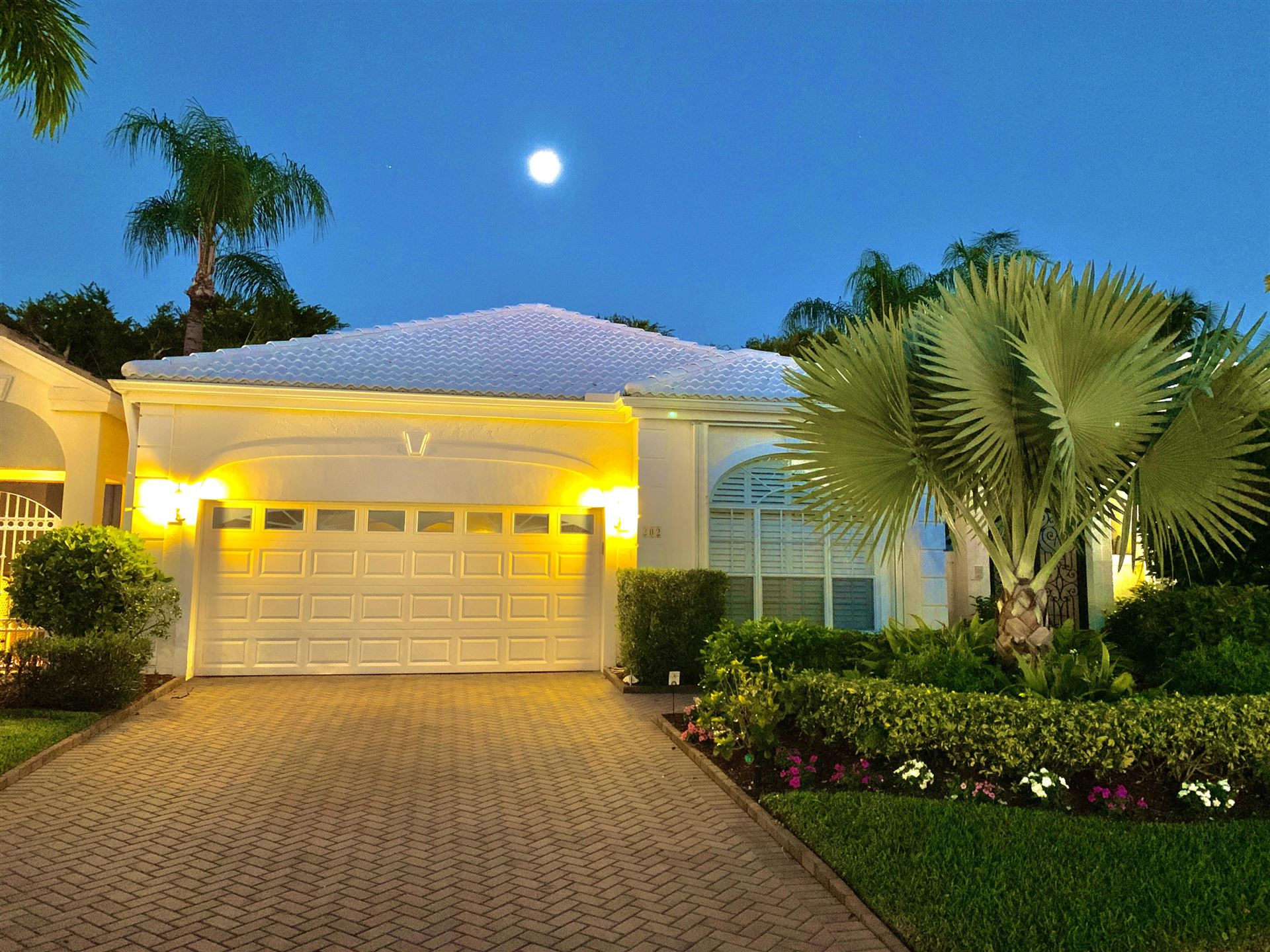 Photo of 202 Coral Cay Terrace, Palm Beach Gardens, FL 33418 (MLS # RX-10693566)