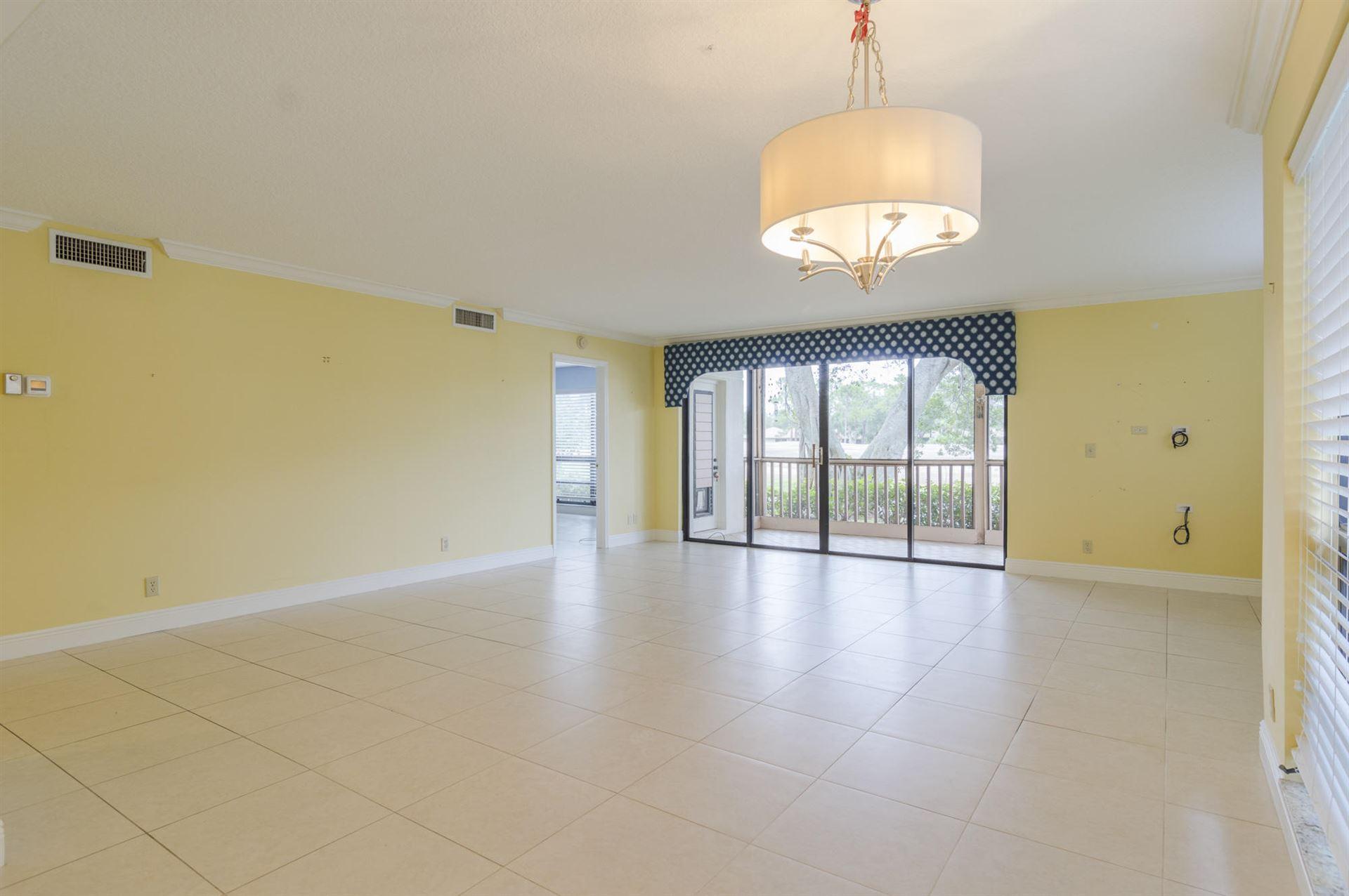 Photo of 445 Brackenwood Lane N, Palm Beach Gardens, FL 33418 (MLS # RX-10629567)