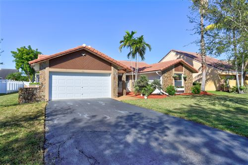 Photo of 412 NW 113th Avenue, Coral Springs, FL 33071 (MLS # RX-10590573)