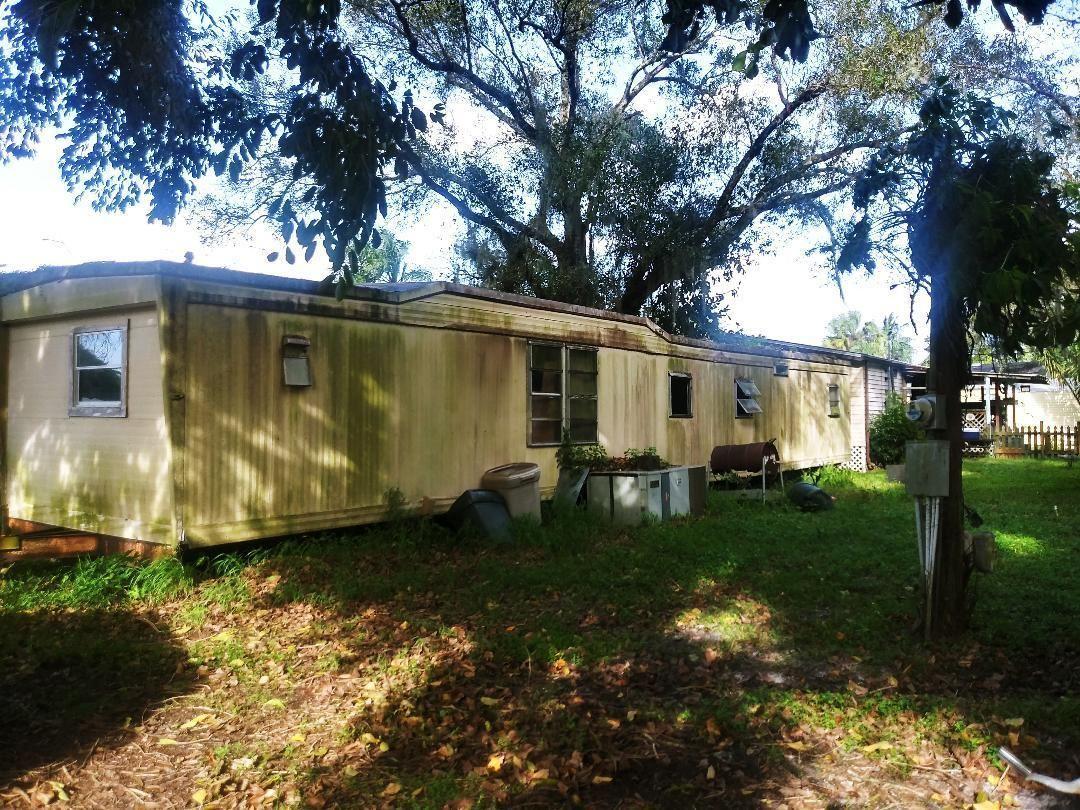 Photo of 1238 SW Buckskin Trail, Stuart, FL 34997 (MLS # RX-10672575)