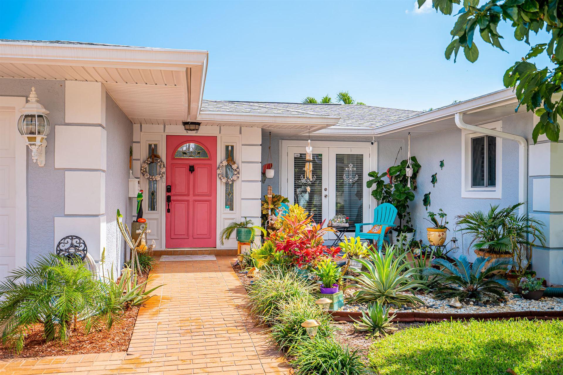 Photo of 905 Evergreen Drive, North Palm Beach, FL 33408 (MLS # RX-10694578)