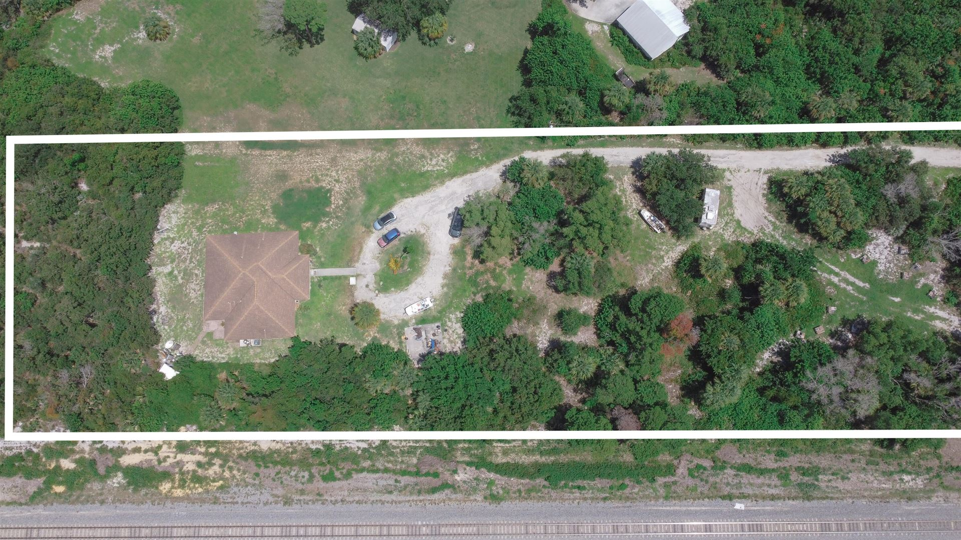 Photo of 8251 SE Dharlys Street, Hobe Sound, FL 33455 (MLS # RX-10745579)