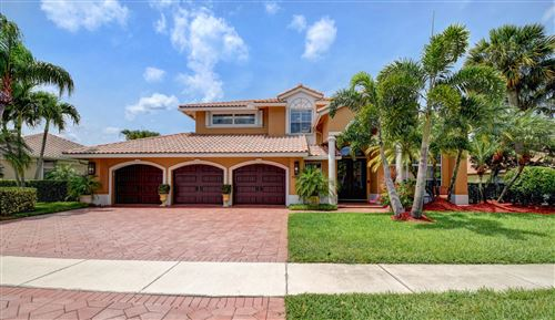 Photo of 10667 Maple Chase Drive, Boca Raton, FL 33498 (MLS # RX-10624583)
