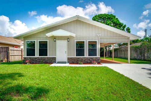 Photo of 6027 Roger Street, Jupiter, FL 33458 (MLS # RX-10732586)
