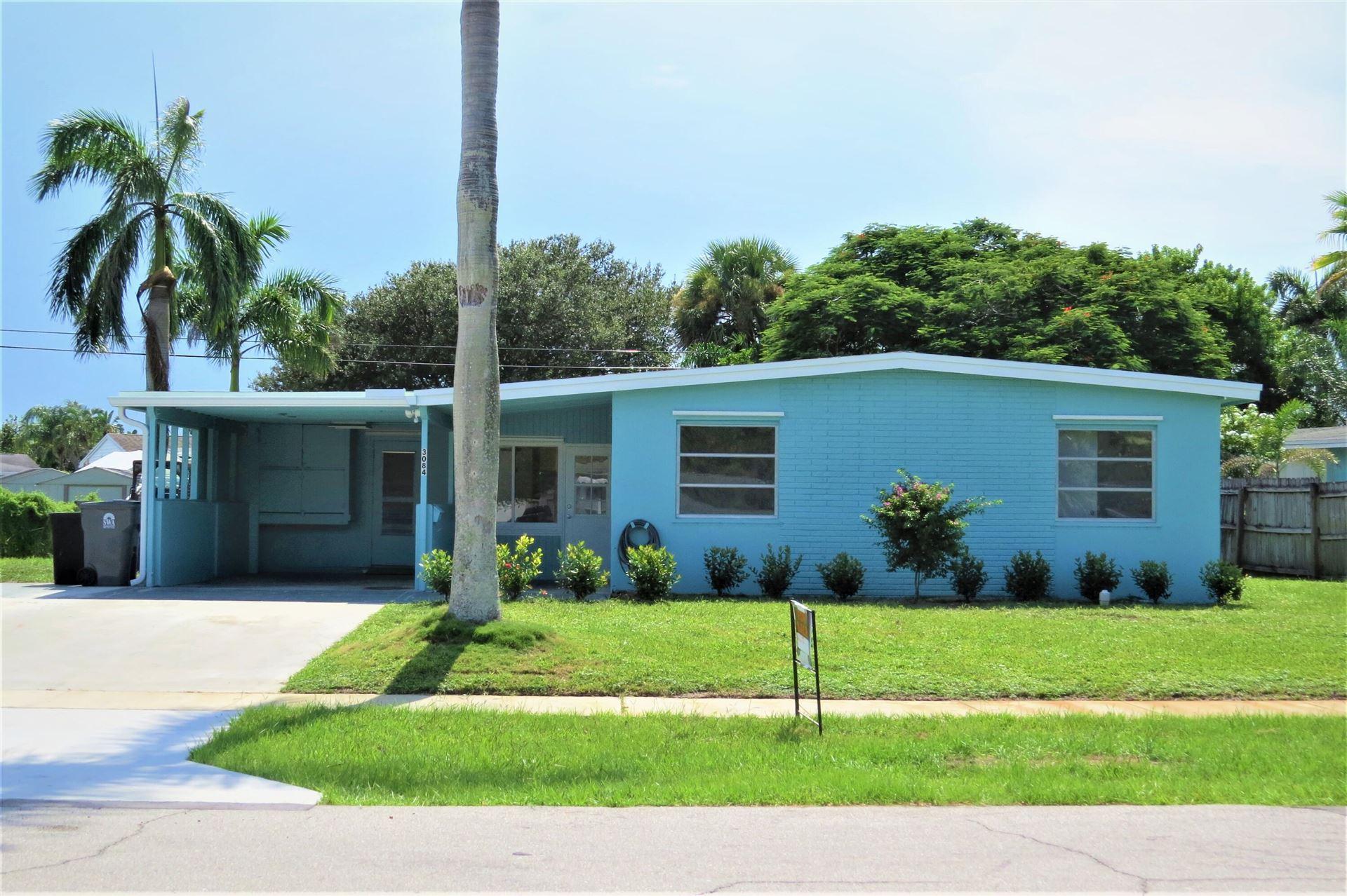 Photo of 3084 Grove Road, Palm Beach Gardens, FL 33410 (MLS # RX-10747586)