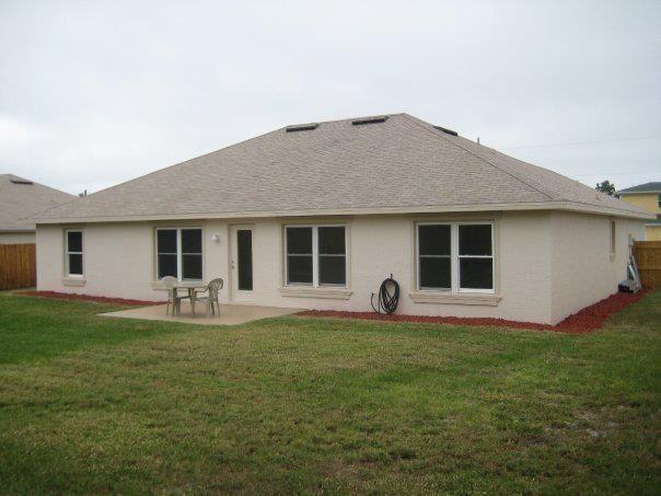 Photo of 373 NE Surfside Avenue, Port Saint Lucie, FL 34983 (MLS # RX-10734590)